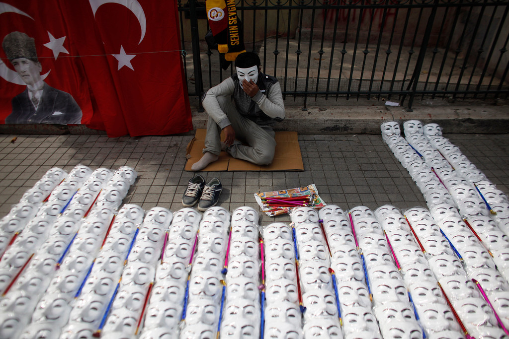. A street vendor sells masks at Taksim square, Istanbul, Turkey, Thursday, June 6, 2013. Turkish officials, scrambling to contain tensions, have delivered more conciliatory messages to thousands of protesters denouncing what they say is the government\'s increasingly authoritarian rule and its meddling in lifestyles. (AP Photo/Kostas Tsironis)