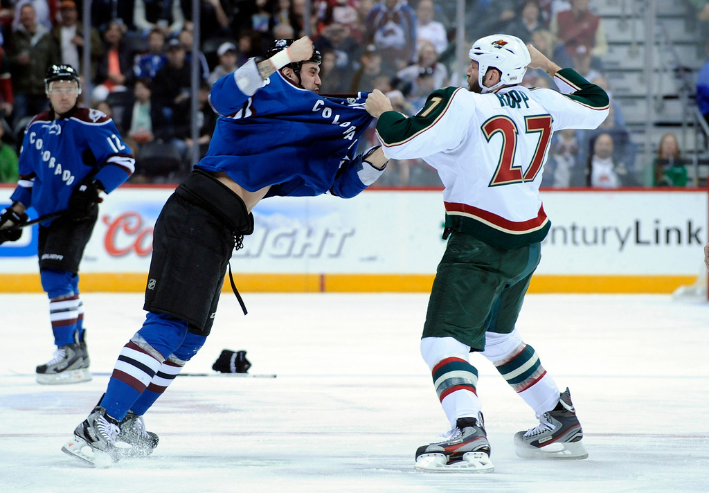 . Colorado Avalanche left wing Patrick Bordeleau, left, and Minnesota Wild left wing Mike Rupp (27) fight during the first period of an NHL hockey game on Saturday, MArch 16, 2013, in Denver. (AP Photo/Jack Dempsey)