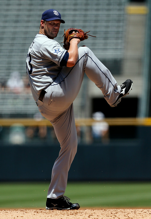 . San Diego Padres starting pitcher Eric Stults throws to the plate against the Colorado Rockies during the first inning of a baseball game on Wednesday, July 9, 2014, in Denver. (AP Photo/Jack Dempsey)