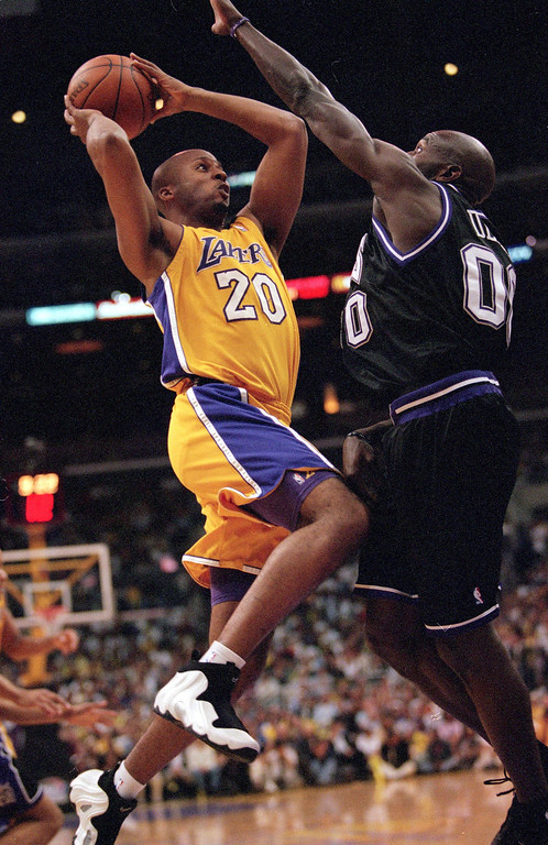 . Brian Shaw #20 of the Los Angeles Lakers leaps for the basket during round one of the NBA Playoffs against the Sacremento Kings at the Staples Centerin Los Angeles, California, in April 2000.  (Tom Hauck  /Allsport)