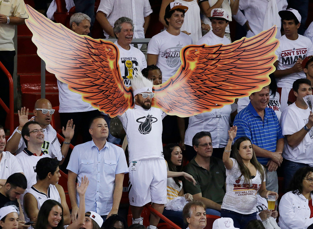. Fans cheers during the second half of Game 6 of the NBA Finals basketball game between the Miami Heat and the San Antonio Spurs, Tuesday, June 18, 2013 in Miami. (AP Photo/Wilfredo Lee)