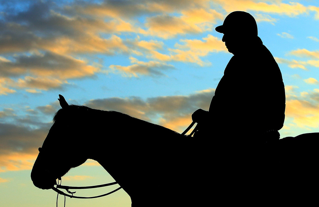 . Trainer D. Wayne Lukas watches early morning workouts at Churchill Downs on May 1, 2014 in Louisville, Kentucky.  (Photo by Jamie Squire/Getty Images)