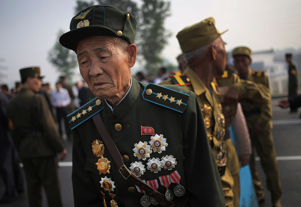 . Old North Korean soldiers arrive in full military dress to pay their respects at the cemeteries of fallen fighters of the Korean People\'s Army (KPA) on Thursday, July 25, 2013 in Pyongyang, North Korea as part of ceremonies marking the 60th anniversary of the signing of the armistice that ended hostilities on the Korean peninsula. (AP Photo/Wong Maye-E)