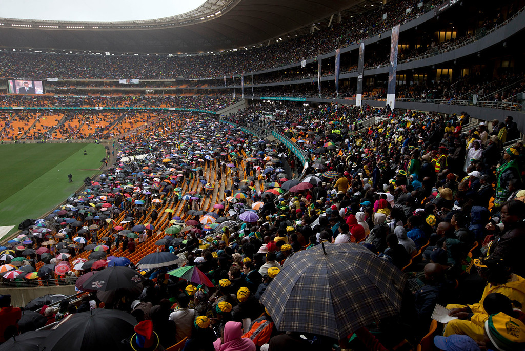 . An image of President Barrack Obama is flashed on a screen as he makes his speech during the memorial service for former South African president Nelson Mandela at the FNB Stadium in Soweto, near Johannesburg, South Africa, Tuesday Dec. 10, 2013. (AP Photo/Peter Dejong)