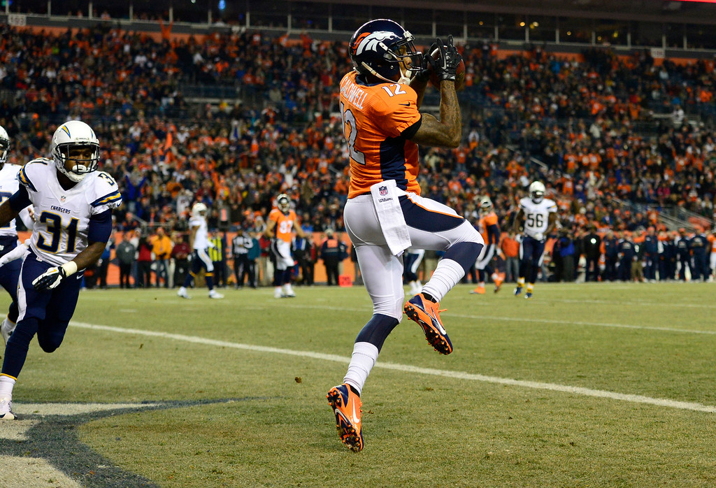 . DENVER, CO - DECEMBER 12: Denver Broncos wide receiver Andre Caldwell (12) ball in hand for the Denver Broncos first quarter touchdown. The Denver Broncos vs. the San Diego Chargers at Sports Authority Field at Mile High in Denver on December 12, 2013. (Photo by AAron Ontiveroz/The Denver Post)