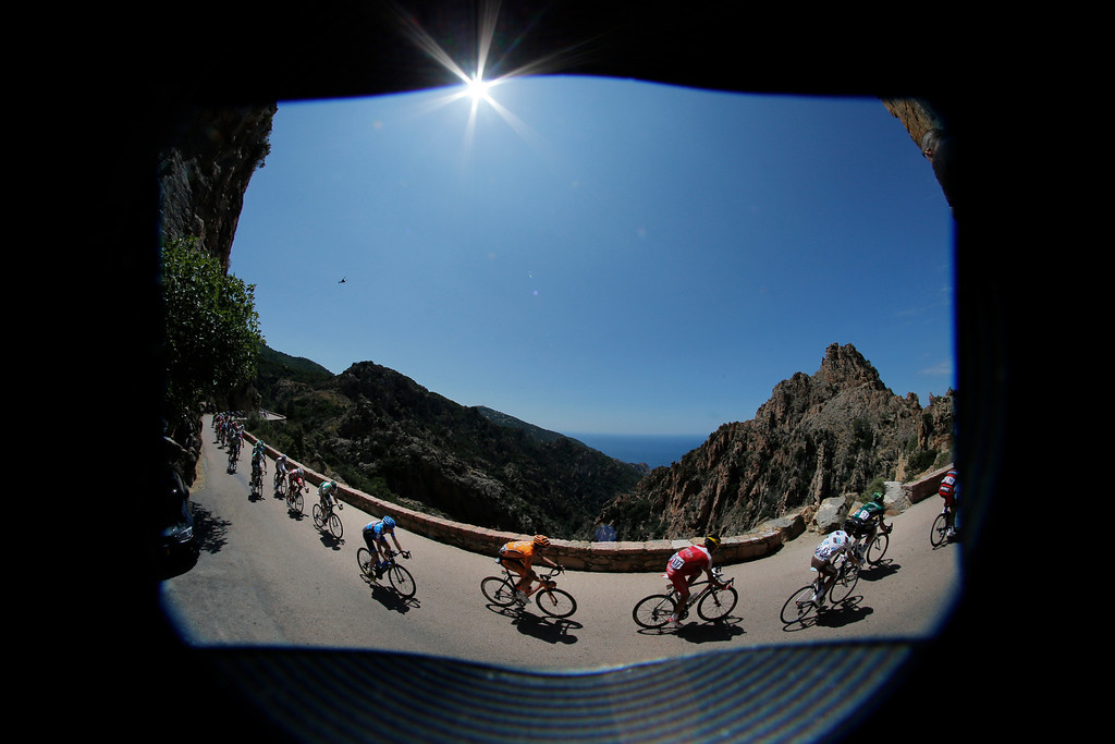 . The pack passes rock formations near Piana during the third stage of the Tour de France cycling race over 145.5 kilometers (91 miles) with start in Ajaccio and finish in Calvi, Corsica island, France, Monday July 1, 2013. (AP Photo/Christophe Ena)
