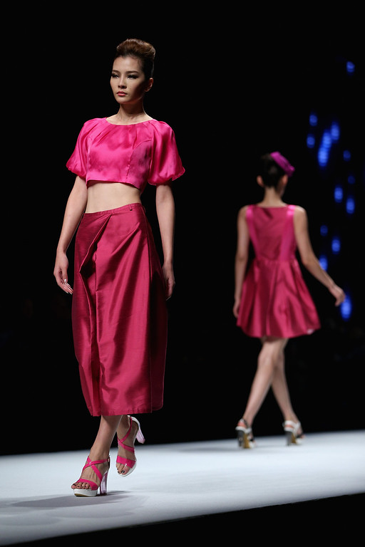 . Models showcase designs by Chinese designer Yuan Bing on the runway at VISCAP Yuan Bing Collection show during Mercedes-Benz China Fashion Week Spring/Summer 2014 at Beijing Hotel on October 28, 2013 in Beijing, China.  (Photo by Feng Li/Getty Images)