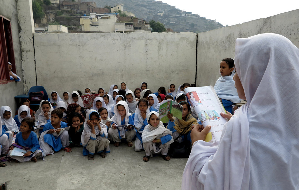 ". A Pakistani female student reads a chapter during a class in a school in Mingora, capital of Swat Valley, hometown of Malala Yousafzai, in Pakistan, Tuesday, Oct. 8, 2013. Malala was a schoolgirl in northwest Pakistan, thinking about calculus and chemistry, Justin Bieber songs and ""Twilight\"" movies. Today she\'s the world-famous survivor of a Taliban assassination attempt, an activist for girls\' education and a contender to win the Nobel Peace Prize on Friday. (AP Photo/Naveed Ali)"
