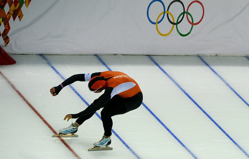 . Silver medallist Koen Verweij of the Netherlands crosses the finish line in the men\'s 1,500-meter speedskating race during the 2014 Winter Olympics in Sochi, Russia, Saturday, Feb. 15, 2014. Verweij lost the gold medal by three thousandth of a second.  (AP Photo/Antonin Thuillier, Pool)