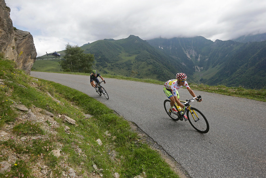 . Stage winner Poland\'s Rafal Majka, wearing the best climber\'s dotted jersey, is followed by Spain\'s Jon Insausti Izaguirre as they speed down Val Louron-Azet pass during the seventeenth stage of the Tour de France cycling race over 124.5 kilometers (77.4 miles) with start in Saint-Gaudens and finish in Saint-Lary, France, Wednesday, July 23, 2014. (AP Photo/Laurent Cipriani)