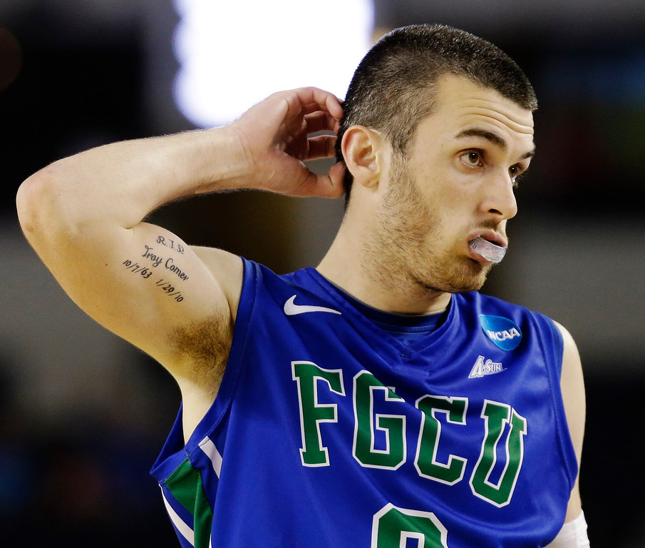 . Florida Gulf Coast\'s Brett Comer (0) reacts during the second half of a regional semifinal game against Florida in the NCAA college basketball tournament, Friday, March 29, 2013, in Arlington, Texas. (AP Photo/David J. Phillip)