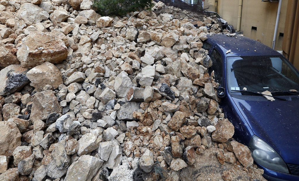 . A vehicule is buried after a rockslide on January 20, 2014 in Nice, southeastern France. Many roads were cut in the Alpes-Maritimes due to landslides, floods and avalanches following heavy rain.  VALERY HACHE/AFP/Getty Images