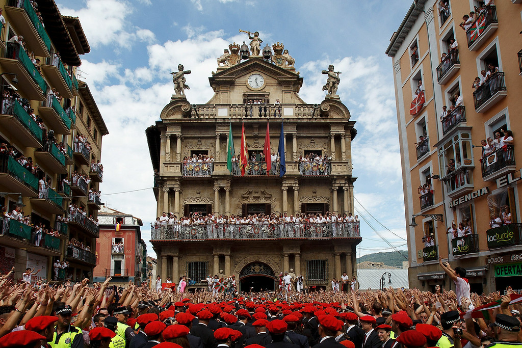 . A band plays music during the opening and the firing of the \'Chupinazo\' rocket which starts the 2014 Festival of the San Fermin Running of the Bulls on July 6, 2014 in Pamplona, Spain. The annual Fiesta de San Fermin, made famous by the 1926 novel of US writer Ernest Hemmingway entitled \'The Sun Also Rises\', involves the daily running of the bulls through the historic heart of Pamplona to the bull ring.  (Photo by Pablo Blazquez Dominguez/Getty Images)