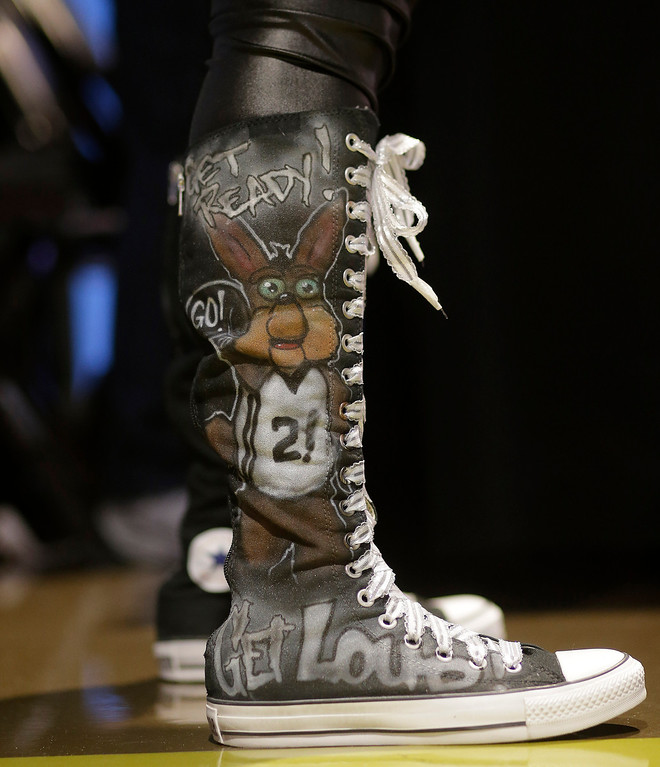 . A San Antonio Spurs fan wears decorated shoes prior to Game 5 of the Western Conference finals NBA basketball playoff series between the Spurs and the Oklahoma City Thunder, Thursday, May 29, 2014, in San Antonio. (AP Photo/Eric Gay)