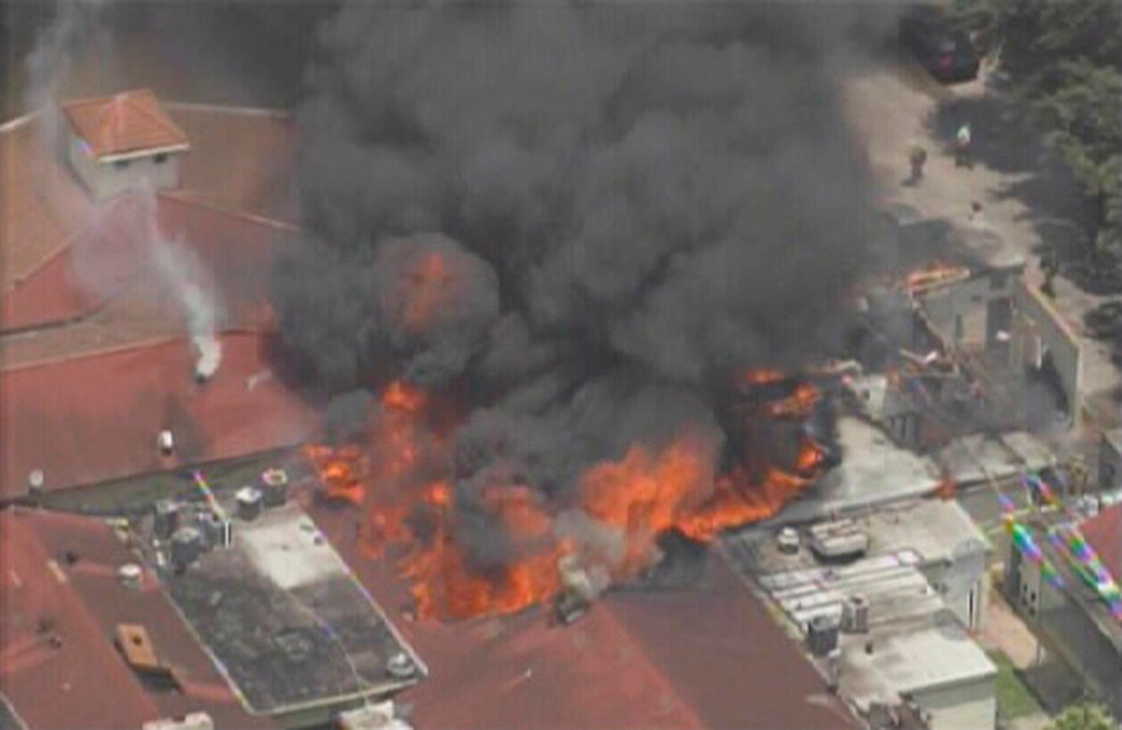 . A five-alarm fire burns at a hotel in southwest Houston, Texas, May 31, 2013 in this image taken from video courtesy of KPRC-Local2. At least six firefighters were injured, two of them very critically, battling a five-alarm fire at a restaurant and hotel in southwest Houston Friday afternoon, the Houston Fire Department said. REUTERS/KPRC-Local2/Handout via Reuters