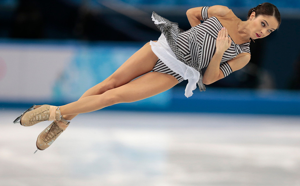 Description of . Vera Bazarova and Yuri Larionov of Russia compete in the pairs short program figure skating competition at the Iceberg Skating Palace during the 2014 Winter Olympics, Tuesday, Feb. 11, 2014, in Sochi, Russia. (AP Photo/Ivan Sekretarev)