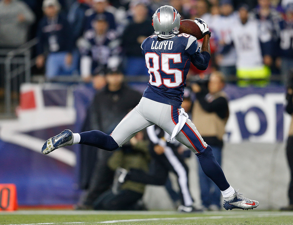 . FOXBORO, MA - DECEMBER 10:  Brandon Lloyd #85 of the New England Patriots catches a touchdown pass against the Houston Texans in the first half at Gillette Stadium on December 10, 2012 in Foxboro, Massachusetts. (Photo by Jim Rogash/Getty Images)