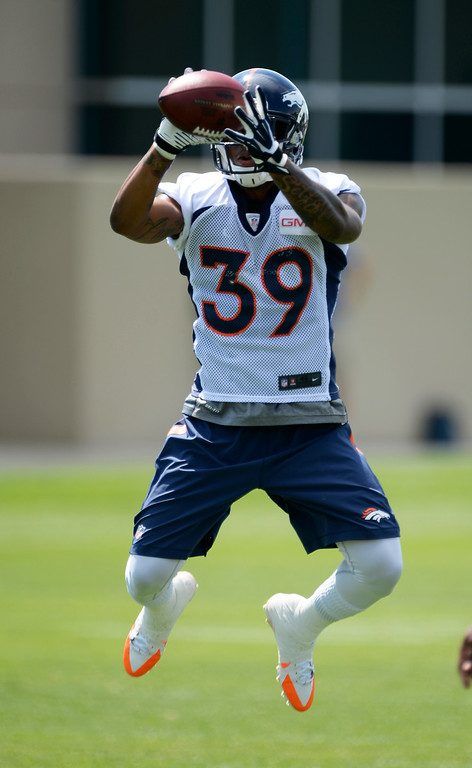 . Denver Broncos defensive back Lou Young (39) catches the football during tip drills on day two of the Denver Broncos 2014 training camp July 25, 2014 at Dove Valley. (Photo by John Leyba/The Denver Post)