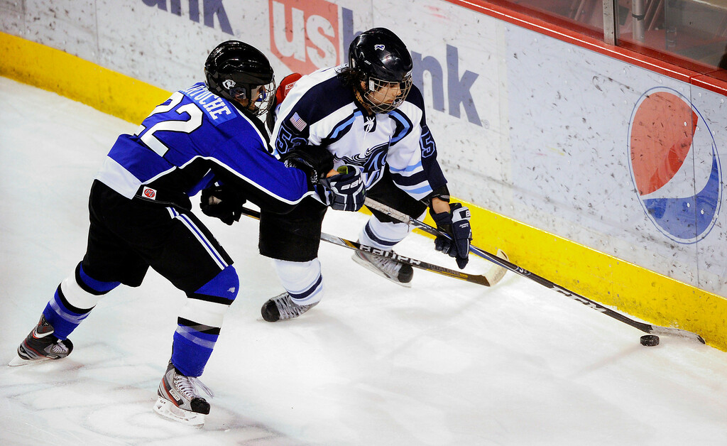 . DENVER, CO. - FEBRUARY 28: Cougars defenseman Paul Sartuche (22) and Mustangs forward Darius Maes (53) went to the boards for a puck in the second period. Ralston Valley High School took on Resurrection Christian Thursday night, February 28, 2013 in a semifinal match in the Colorado State Ice Hockey Championships at Magness Arena in Denver. (Photo By Karl Gehring/The Denver Post)