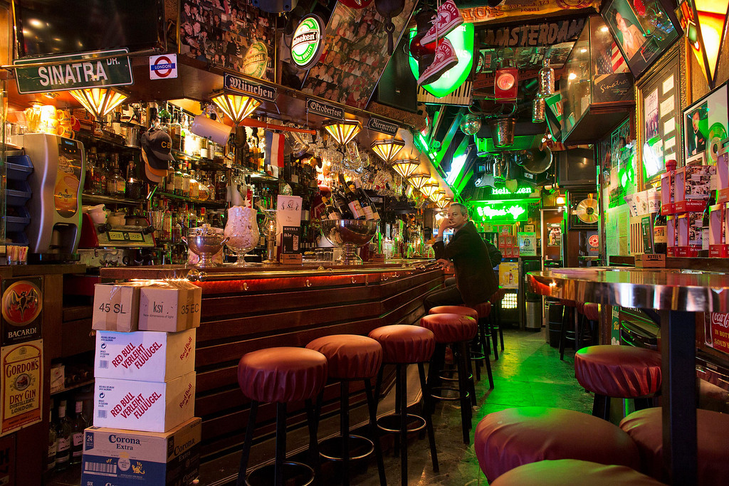 . A man sits at the bar of old fashioned cafe Het Spuitje at the Spuistraat in Amsterdam April 28, 2013. The Royal celebrations in the Netherlands this week put the country and the capital Amsterdam on front pages and television screens around the world with an orange splash.  There\'s plenty to see and do in 48 hours in this compact city, where the world-famous Rijksmuseum only recently reopened after an extensive renovation. Picture taken April 28, 2013. REUTERS/Michael Kooren
