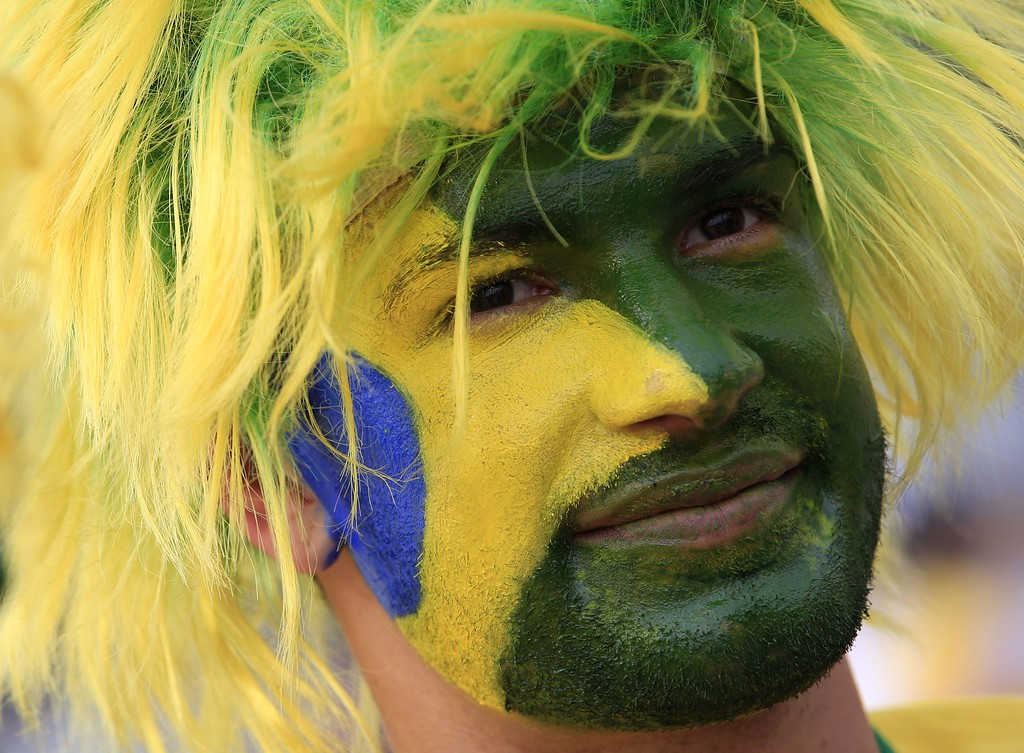 . A Brazilian fan waits outside the Mineirao Stadium in Belo Horizonte before the semi-final football match between Brazil and Germany during the 2014 FIFA World Cup on July 8, 2014. AFP PHOTO / ADRIAN  DENNIS/AFP/Getty Images