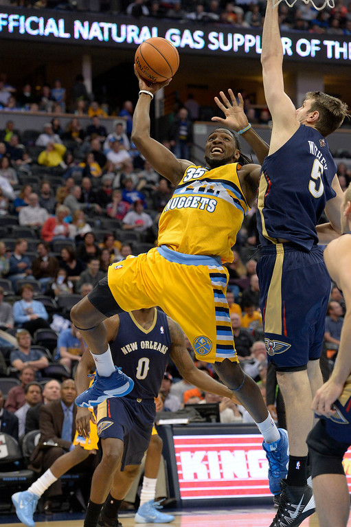 . Denver Nuggets forward Kenneth Faried (35) takes a shot on New Orleans Pelicans center Jeff Withey (5) during the fourth quarter April 2, 2014 at the Pepsi Center in Denver. The Denver Nuggets defeated the New Orleans Pelicans 137-107. (Photo by John Leyba/The Denver Post)