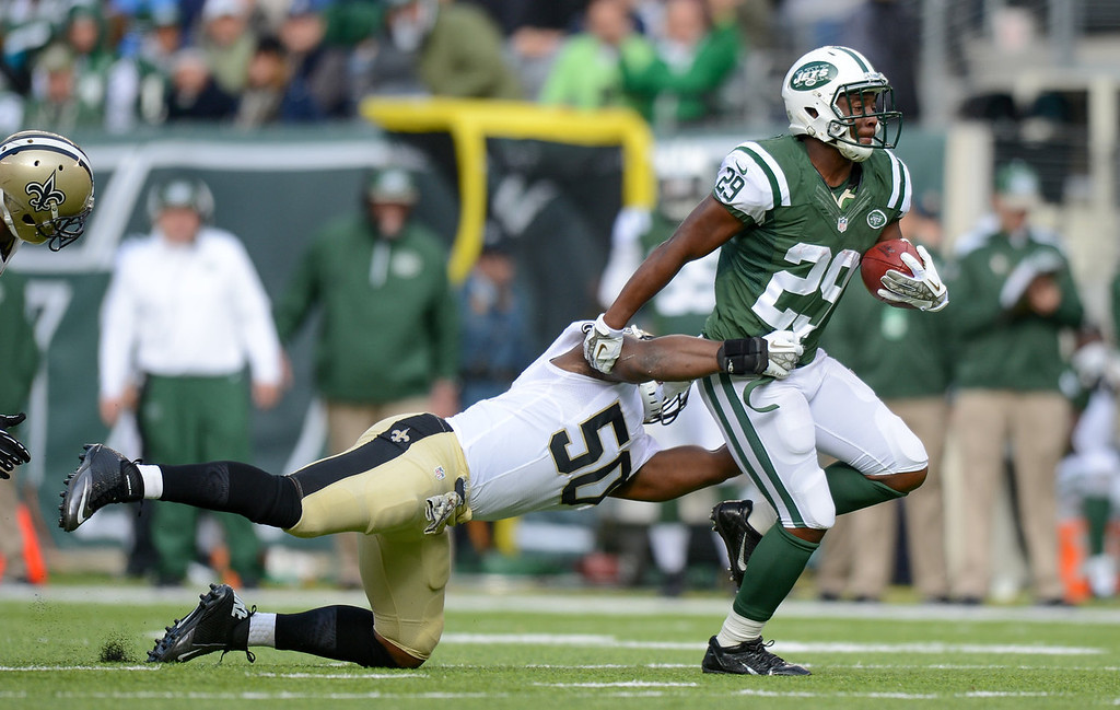 . Running back Bilal Powell #29 of the New York Jets is tackled by middle linebacker Curtis Lofton #50 of the New Orleans Saints  in the 2nd  quarter  at MetLife Stadium on November 3, 2013 in East Rutherford, New Jersey. (Photo by Ron Antonelli/Getty Images)