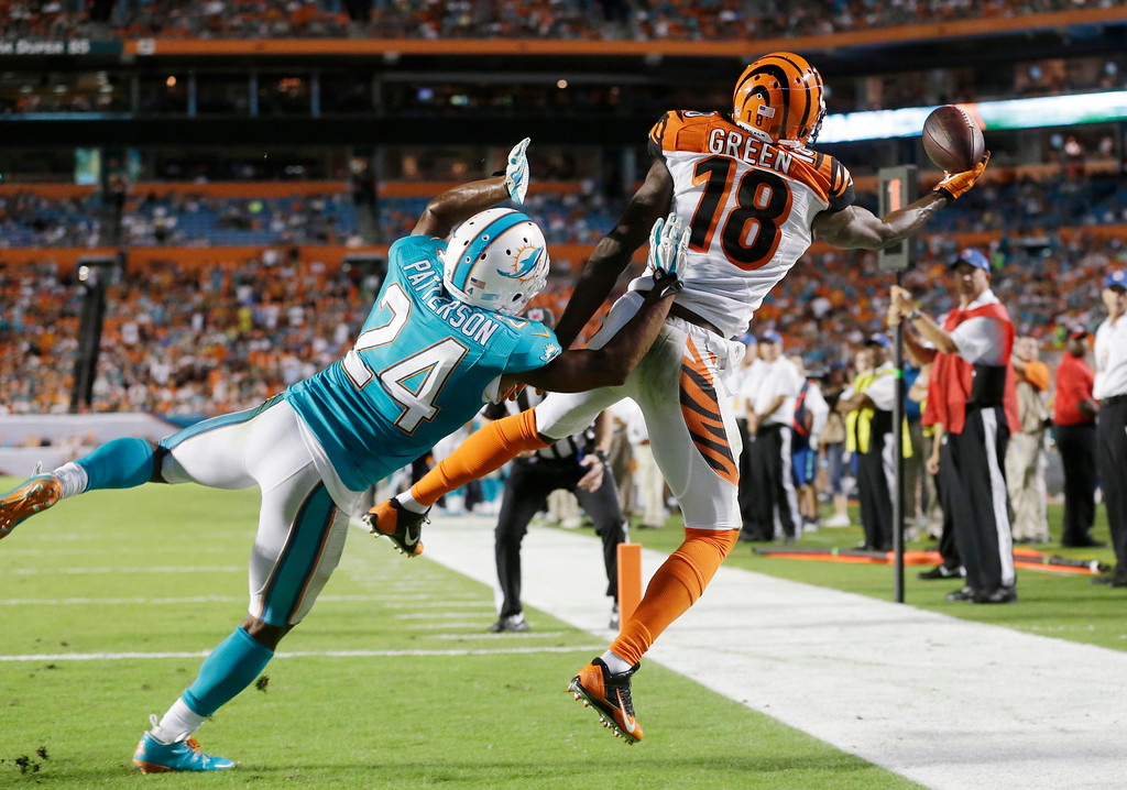 . Cincinnati Bengals wide receiver A.J. Green (18) can\'t hold on to a pass in the end zone as Miami Dolphins cornerback Dimitri Patterson (24) defends during the second half of an NFL football game, Thursday, Oct. 31, 2013, in Miami Gardens, Fla. (AP Photo/Wilfredo Lee)