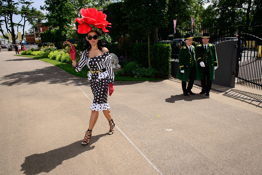 . Model Eliza Cortez poses for photographers on the first day of Royal Ascot, in Berkshire, west of London, on June 17, 2014.  AFP PHOTO / LEON NEAL/AFP/Getty Images