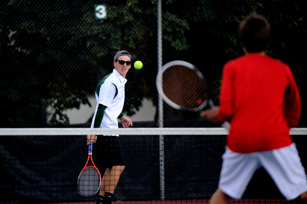 . DENVER, CO. - OCT 12:   Fossil Ridge player Trevor Swambom watches his return during a doubles match against Regis Jesuit players.   (Photo By Erin Hull/The Denver Post)