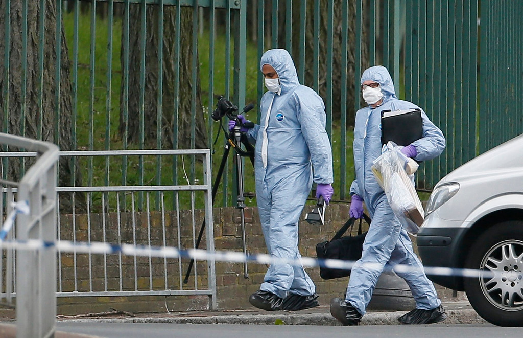 . Police forensics officers investigate a crime scene where one man was killed in Woolwich, southeast London May 22, 2013.  REUTERS/Stefan Wermuth