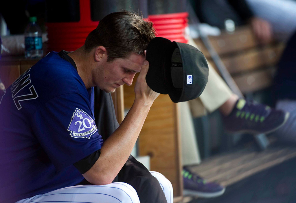 . Colorado Rockies starting pitcher Drew Pomeranz #13 wipes sweat from his forehead during the third inning of a Major League Baseball game against the Miami Marlins on July 22, 2013 at Coors Field in Denver. (Photo By Grant Hindsley/The Denver Post)