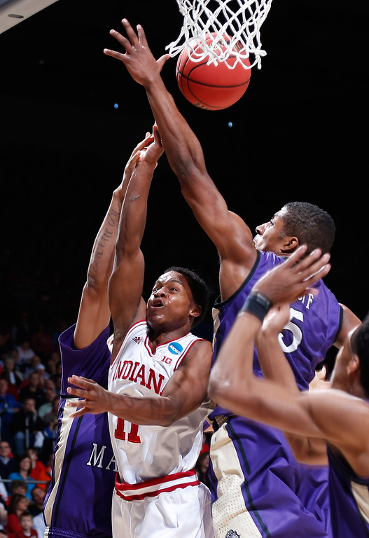 . DAYTON, OH - MARCH 22: Yogi Ferrell #11 of the Indiana Hoosiers drives to the basket against Alioune Diouf #5 of the James Madison Dukes in the second half during the second round of the 2013 NCAA Men\'s Basketball Tournament at UD Arena on March 22, 2013 in Dayton, Ohio.  (Photo by Joe Robbins/Getty Images)