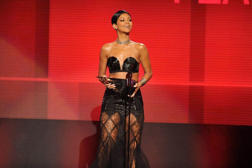 . Rihanna accepts the award for favorite female artist - soul/R&B at the American Music Awards at the Nokia Theatre L.A. Live on Sunday, Nov. 24, 2013, in Los Angeles. (Photo by John Shearer/Invision/AP)
