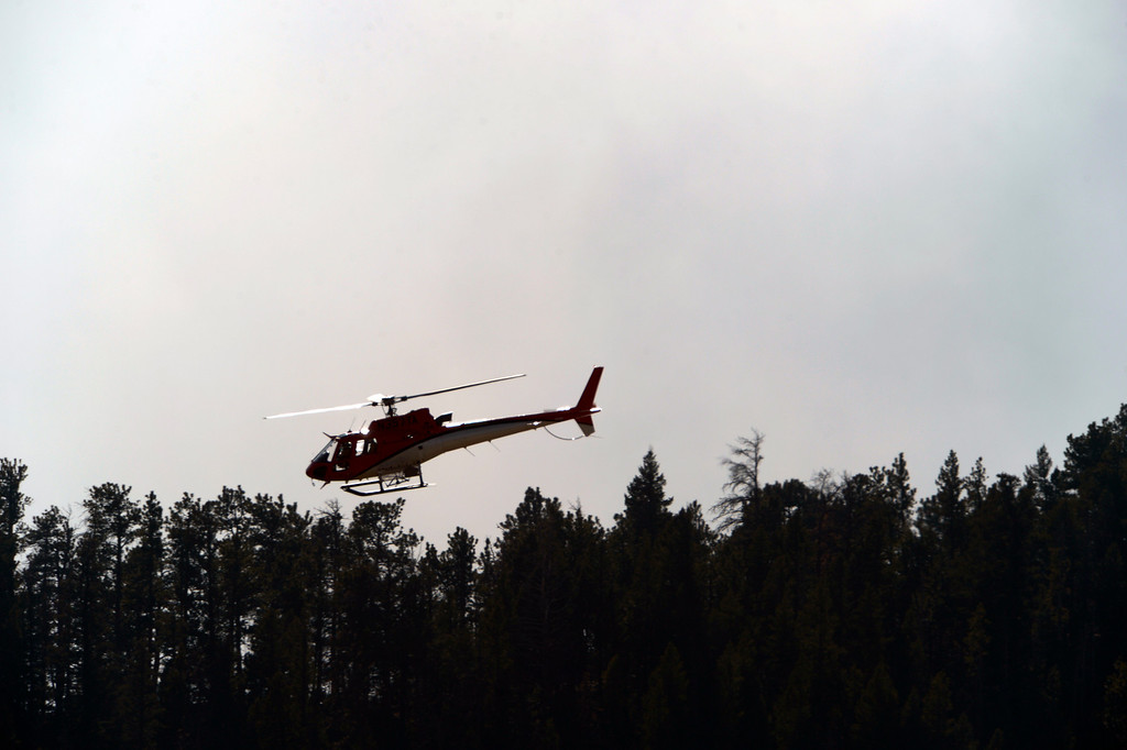 . A reconnaissance helicopter flies near the fire.  Officials are worried about winds kicking up later in the afternoon on December 2, 2012. The Fern Lake Fire, which has been burning in Rocky Mountain National Park since October, kicked up yesterday and forced the evacuation of hundreds of homes east of the fire. Helen H. Richardson, The Denver Post