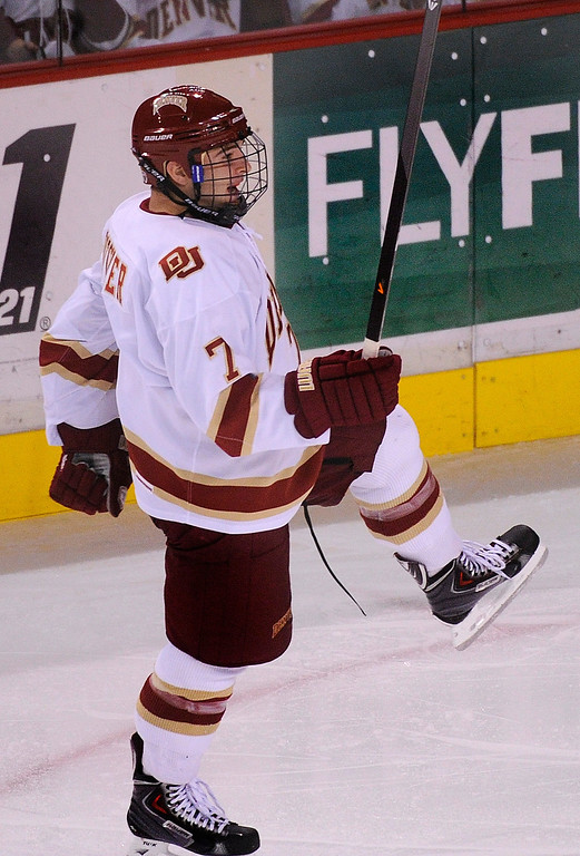 . DENVER, CO. - OCTOBER 12: Denver freshman defenseman Will Butcher found the back of the net in the second period. The University of Denver hockey team hosted Merrimack at Magness Arena, Saturday night, October 12, 2013. Photo By Karl Gehring/The Denver Post