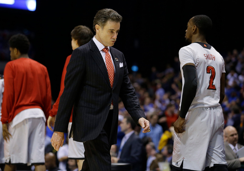 . Louisville head coach Rick Pitino walks off after an NCAA Midwest Regional semifinal college basketball tournament game against the Kentucky Saturday, March 29, 2014, in Indianapolis. Kentucky won 74-69. (AP Photo/Michael Conroy)