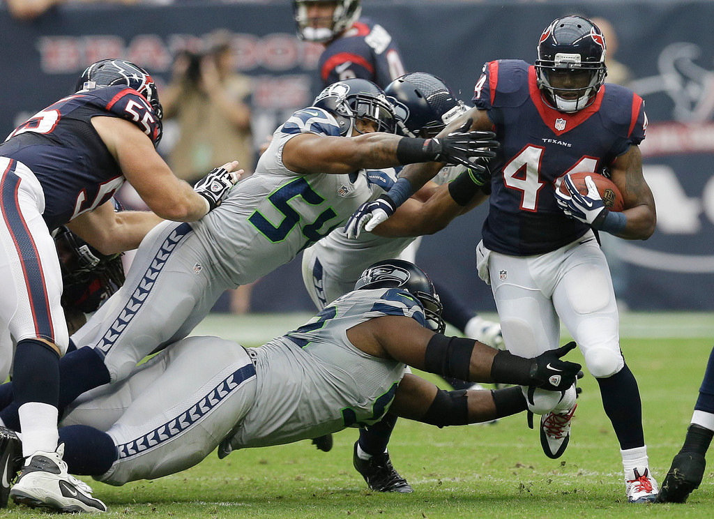 . Houston Texans\' Ben Tate (44) runs past Seattle Seahawks\' Bobby Wagner (54) during the first quarter an NFL football game Sunday, Sept. 29, 2013, in Houston. (AP Photo/David J. Phillip)