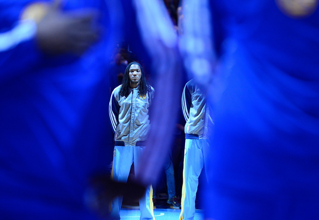 . DENVER, CO. - APRIL 23: Denver Nuggets small forward Kenneth Faried (35) stands for the NAtional Anthem before the game. The Denver Nuggets took on the Golden State Warriors in Game 2 of the Western Conference First Round Series at the Pepsi Center in Denver, Colo. on April 23, 2013. (Photo by AAron Ontiveroz/The Denver Post)