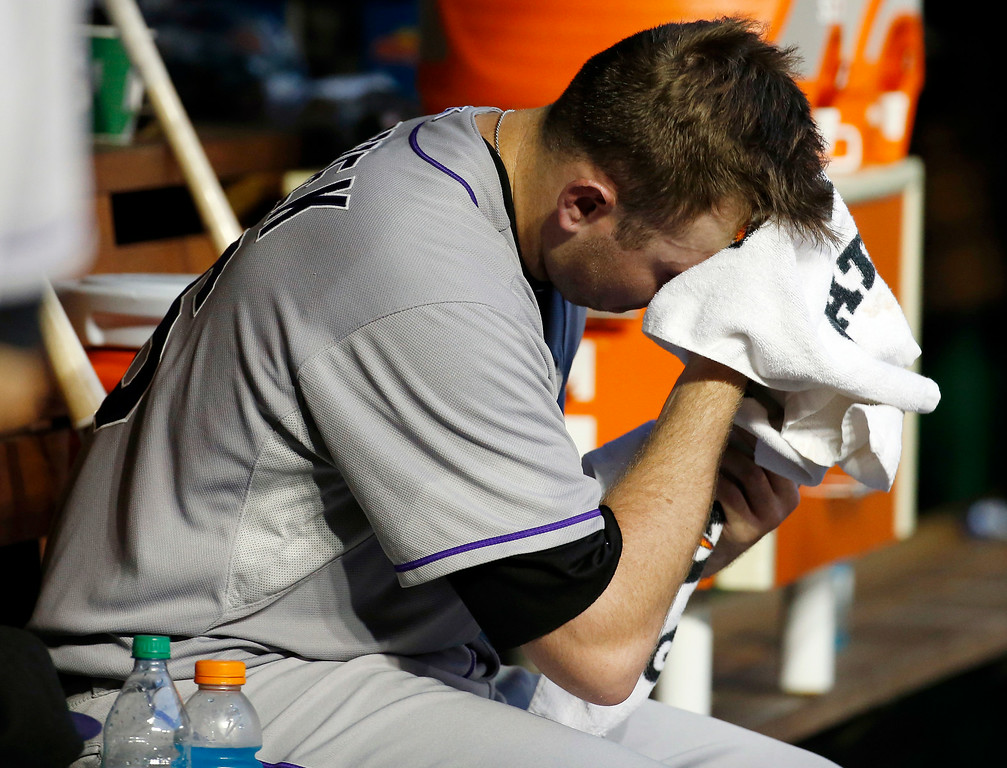 . Colorado Rockies starting pitcher Tyler Matzek wipes his face after being relieved during the seventh inning of a baseball game against the Washington Nationals at Nationals Park, Wednesday, July 2, 2014, in Washington. The Nationals won 4-3. (AP Photo/Alex Brandon)