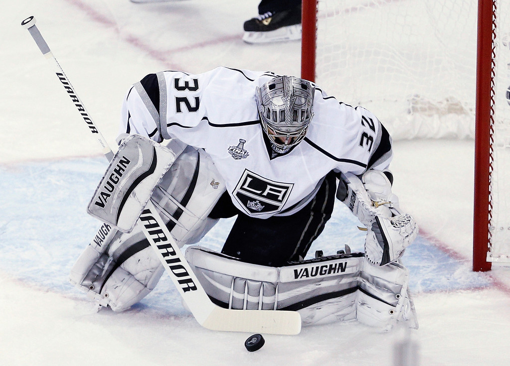 . Jonathan Quick #32 of the Los Angeles Kings makes a save against the New York Rangers during the first period of Game Four of the 2014 NHL Stanley Cup Final at Madison Square Garden on June 11, 2014 in New York, New York.  (Photo by Paul Bereswill/Getty Images)
