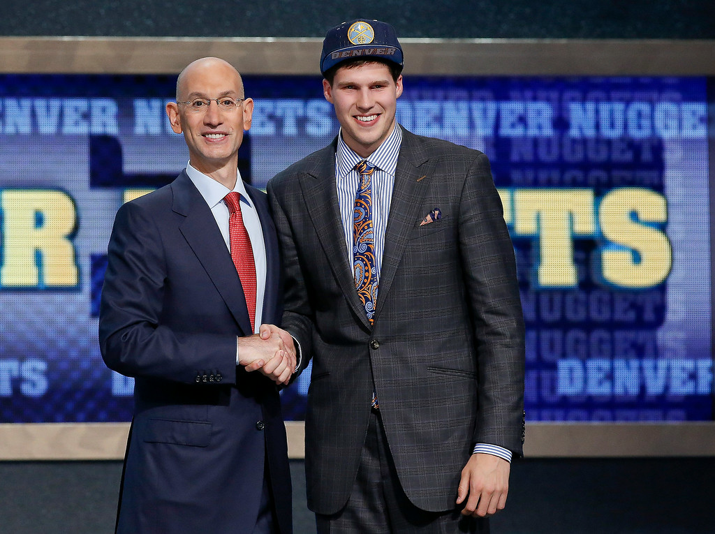 . Creighton\'s Doug McDermott, right, poses for a photo with NBA Commissioner Adam Silver after being selected 11th overall by the Denver Nuggets during the 2014 NBA draft, Thursday, June 26, 2014, in New York. The Nuggets then traded McDermott to the Chicago Bulls. (AP Photo/Kathy Willens)