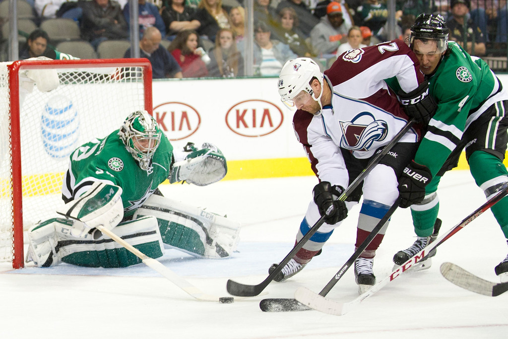 . DALLAS, TX - NOVEMBER 1:  Kari Lehtonen #32 of the Dallas Stars blocks a shot by Marc-Andre Cliche #24 of the Colorado Avalanche on November 1, 2013 at the American Airlines Center in Dallas, Texas.  (Photo by Cooper Neill/Getty Images)