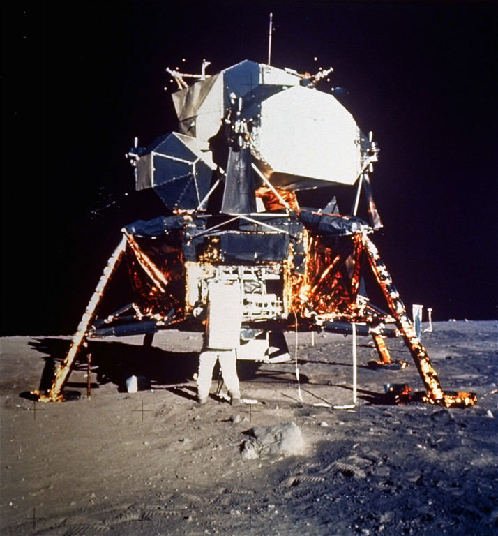 . Astronaut Edwin E. Aldrin Jr., lunar module pilot, prepares to deploy the Early Apollo Scientific Experiments Package (EASEP) during Apollo 11 lunar surface extravehicular activity, July 20, 1969.  Astronaut Neil A. Armstrong, commander, took this photograph with a 70 mm lunar surface camera.  Aldrin is removing the EASEP from its stowed position. (AP Photo/NASA/Neil A. Armstrong)