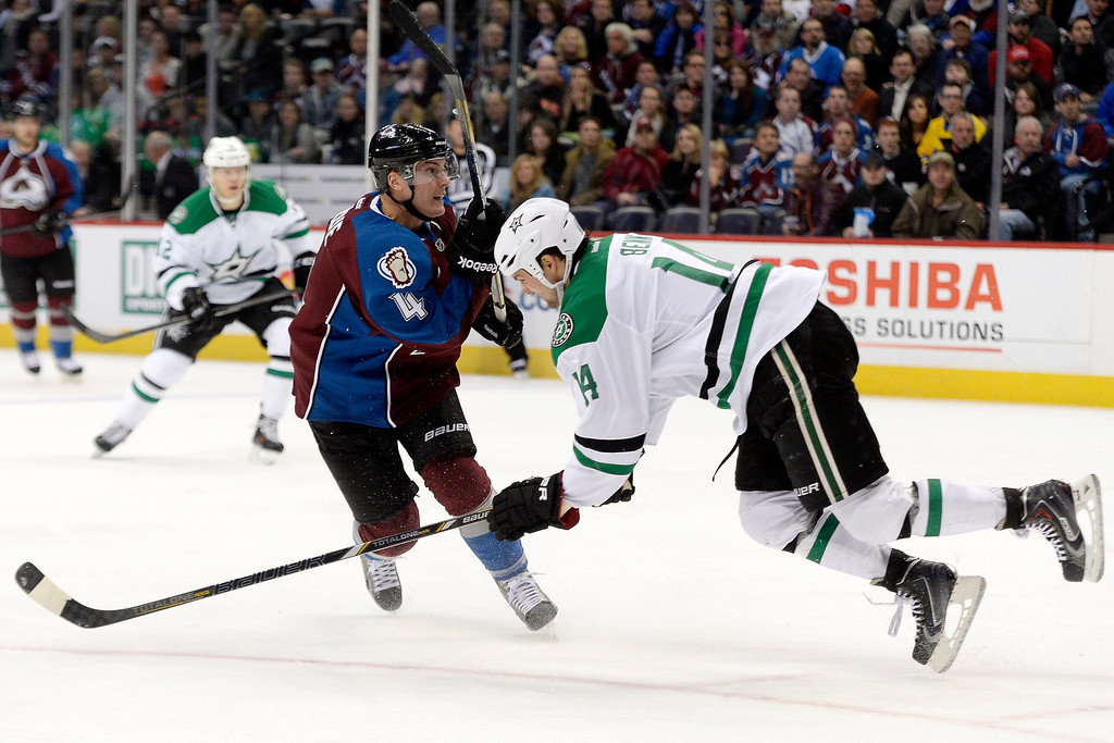 . DENVER, CO - DECEMBER 16: Colorado Avalanche defenseman Tyson Barrie (4) takes a shot as Dallas Stars left wing Jamie Benn (14) defends during the third period of the Avs\' 6-2 win. The Colorado Avalanche hosted the Dallas stars at the Pepsi Center. (Photo by AAron Ontiveroz/The Denver Post)