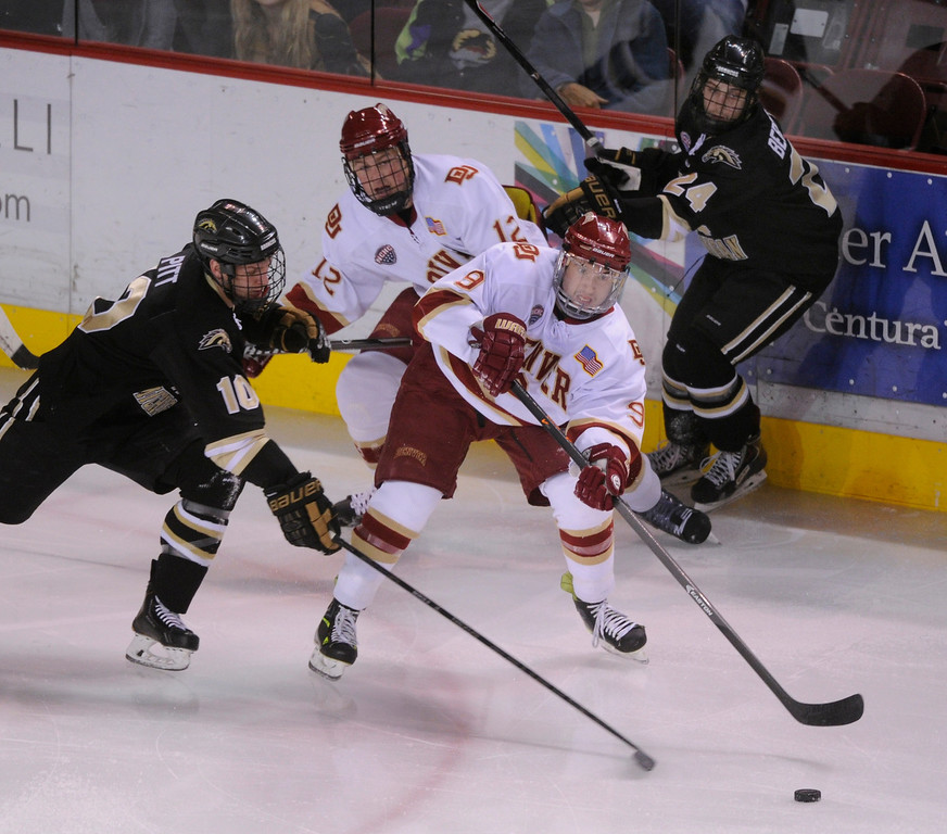 . DENVER, CO. - NOVEMBER 16: Denver center Gabe Levin (9) tried to center the puck in the first period. The University of Denver hockey team hosted Western Michigan at Magness Arena Saturday night, November 16, 2013.  Photo By Karl Gehring/The Denver Post