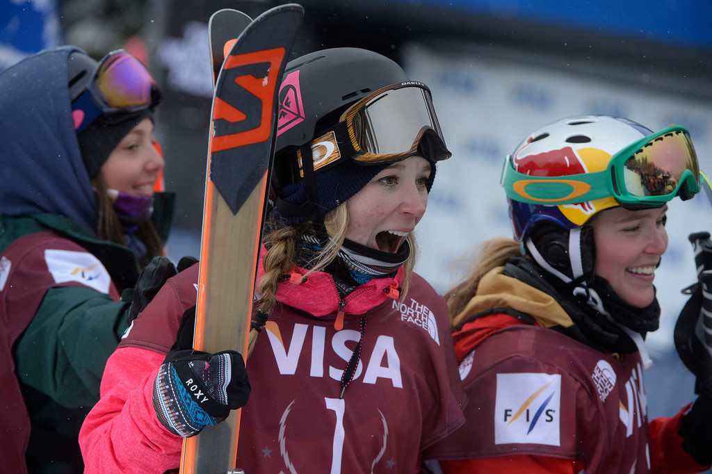 . Dara Howell, CAN, center, reacts after winning the U.S. Grand Prix slope style finals at the Copper Mountain ski area Saturday afternoon, December 21, 2013. Competitors, Darian Stevens, left, finished second, and Grete Eliassen, right, finished third. (Photo By Andy Cross / The Denver Post)