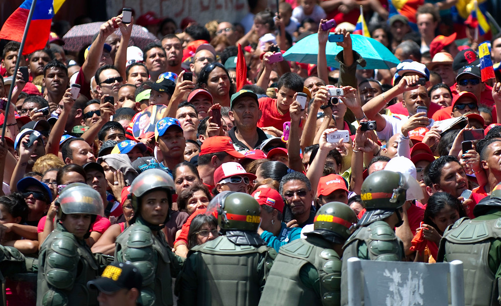 . Thousands of supporters of the late Venezuelan President Hugo Chavez wait for the passage of the funeral cortege on its way to the Military Academy, on March 6, 2013, in Caracas.  AFP PHOTO/Juan  BARRETO/AFP/Getty Images