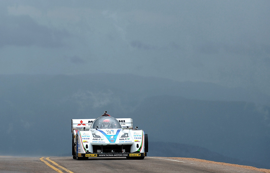 . Nobuhiro Tajima, of Japan, driver of the #1 E-RUNNER Pikes Peak Special, races up the mountain in the Pikes Peak International Hill Climb on June 30, 2013 in Colorado Springs, Colorado. (Photo by Rainier Ehrhardt/Getty Images)
