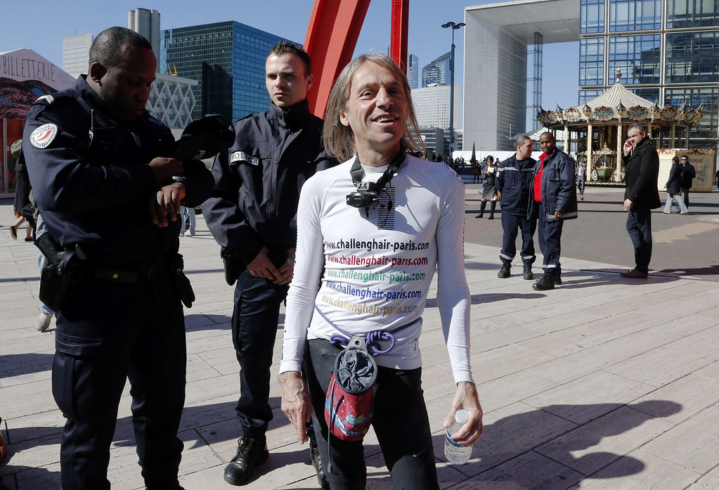 . Alain Robert, the French urban climber dubbed Spiderman, smiles after climbing the Total company\'s headquarters, a 186-meter high skyscraper, at the business district of La Defense, near Paris, on March 20, 2014.  AFP PHOTO / FRANCOIS GUILLOT/AFP/Getty Images